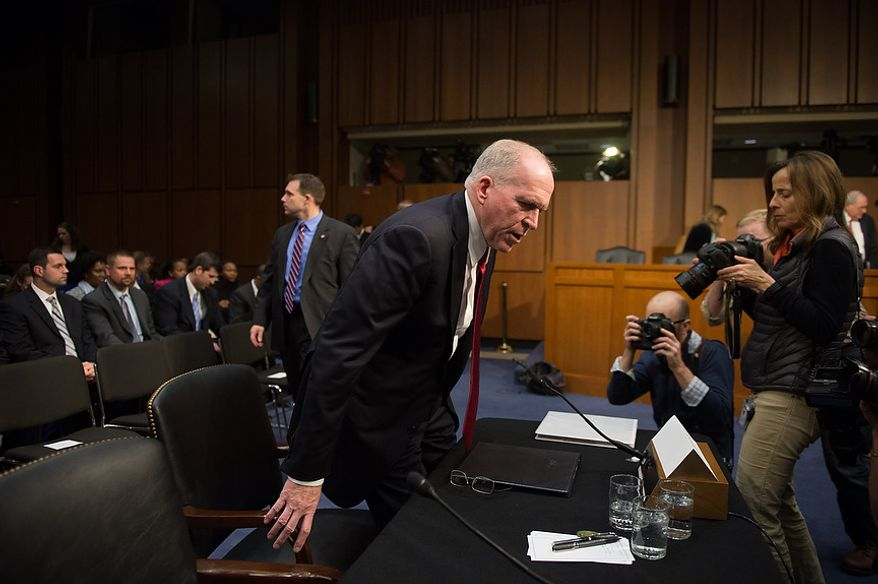 John O. Brennan returns to a room emptied of spectators to continue his opening remarks, which were interrupted by anti-war protesters as he testified before the Senate Select Committee on Intelligence at a hearing on Capitol Hill in Washington on Thursday, Feb. 7, 2013, on his nomination to head the Central Intelligence Agency. (Andrew Harnik/The Washington Times)