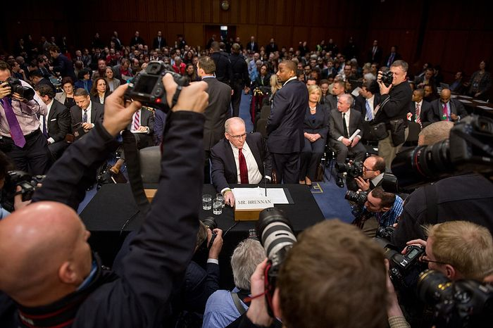 John O. Brennan (center) arrives to testify before the Senate Select Committee on Intelligence at a hearing on Capitol Hill in Washington on Thursday, Feb. 7, 2013, on his nomination to head the Central Intelligence Agency. (Andrew Harnik/The Washington Times)
