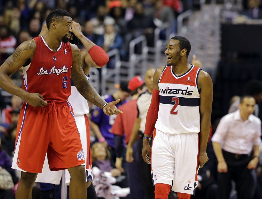 Los Angeles Clippers center DeAndre Jordan (6) and Washington Wizards guard John Wall (2) talk during a timeout in the second half of an NBA basketball game Monday, Feb. 4, 2013 in Washington. The Wizards won 98-90. (AP Photo/Alex Brandon)