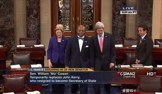 "This video frame grab image provided by C-SPAN2 shows William ""Mo"" Cowan, center, accompanied by Sen. Elizabeth Warren, D-Mass., left, and Secretary of State John Kerry, on Capitol Hill in Washington, Thursday, Feb. 7, 2013, to officially be sworn into the Senate by Vice President Joseph R. Biden. Cowan was chosen by Massachusetts Gov. Deval Patrick to replace Kerry. (AP Photo/C-SPAN2)"