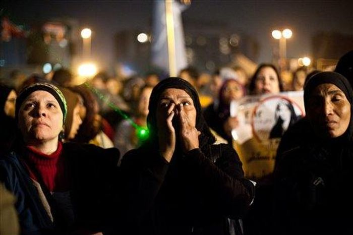 Egyptian women gather to denounce sexual violence and harassment against women in Cairo, Egypt, Wednesday, Feb. 6. Mob-led sexual assaults targeting Egypt's female protesters could increase if perpetrators are not punished, an international rights group warned on Wednesday. (Associated Press)