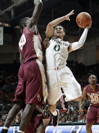 Miami's Shane Larkin (0) prepares to shoot against Florida State's Michael Ojo (50) during the first half of an NCAA college basketball game in Coral Gables, Fla., Sunday, Jan. 27, 2013. (AP Photo/Alan Diaz)