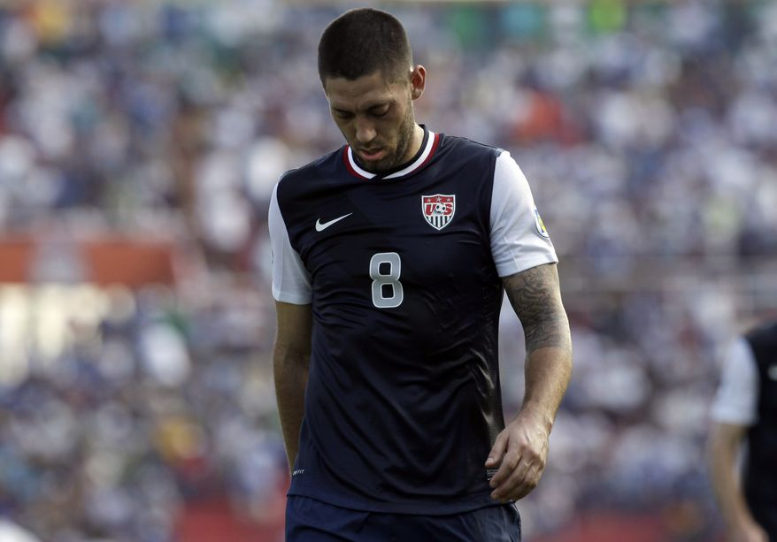 U.S. Clint Dempsey leaves the field at the end of the first half of a 2014 World Cup qualifying soccer game against Honduras in San Pedro Sula, Honduras, Wednesday Feb. 6, 2013. (AP Photo/Moises Castillo)