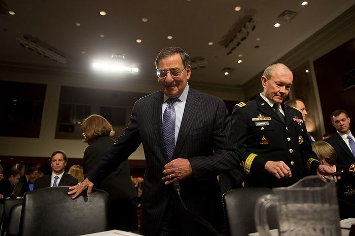 Secretary of Defense Leon E. Panetta (center) and Army Gen. Martin E. Dempsey (right), chairman of the Joint Chiefs of Staff, arrive to testify before the Senate Armed Services Committee on Capitol Hill in Washington on Thursday, Feb. 7, 2013, on the Defense Department's response to the attack on U.S. facilities in Benghazi, Libya. (Andrew Harnik/The Washington Times)