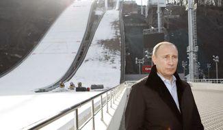 Russian President Vladimir Putin visits a ski-jumping complex in Krasnaya Polyana near the Black Sea resort of Sochi, southern Russia, Wednesday, Feb. 6, 2013. (AP Photo/Sergei Karpukhin, Pool)