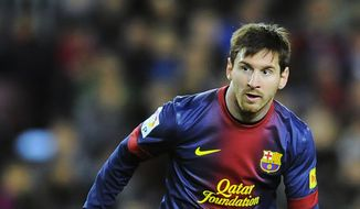 Barcelona's Lionel Messi, from Argentina, tries to controls the ball during his team's Spanish League soccer match against Osasuna, at Camp Nou stadium in Barcelona, Spain, Sunday, Jan. 27, 2013. Barcelona won the match 5-1. (AP Photo/Alvaro Barrientos)