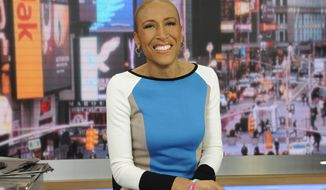 """Good Morning America"" co-anchor Robin Roberts is pictured on the set in New York on Thursday, Jan. 24, 2013. (AP Photo/ABC, Ida Mae Astute)"