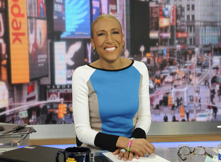 """""""Good Morning America"""" co-anchor Robin Roberts is pictured on the set in New York on Thursday, Jan. 24, 2013. (AP Photo/ABC, Ida Mae Astute)"""