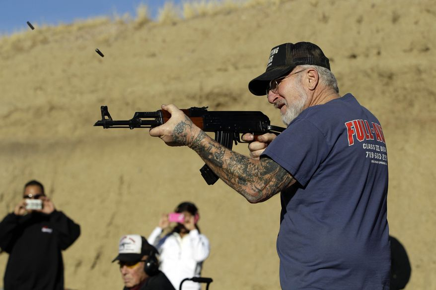 **FILE** Gun dealer Mel Bernstein fires his AK-47 assault rifle on full automatic at his own Dragonman's shooting range and gun store, east of Colorado Springs, Colo., on Feb. 5, 2013. (Associated Press)