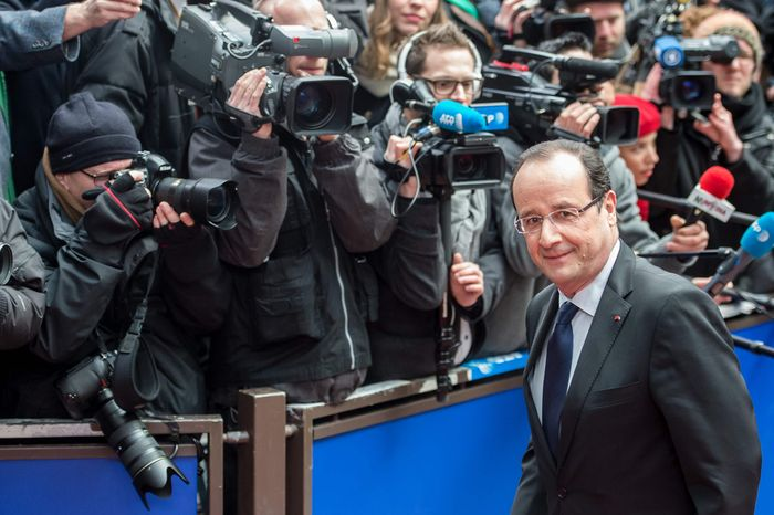 ** FILE ** French President Francois Hollande arrives during an EU Budget summit at the European Council building in Brussels, Thursday, Feb. 7, 2013. (AP Photo/Geert Vanden Wijngaert)