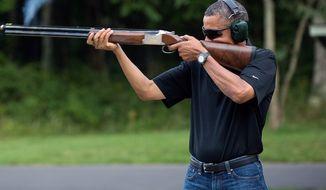 Official White House photo of President Obama shooting a shotgun on Aug. 4, 2012.