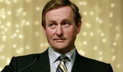 ** File ** Irish Prime Minister Enda Kenny addresses party members at the Burlington Hotel on Dublin on Feb. 26, 2011. (Associated Press)