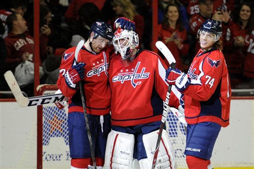 Goalie Braden Holtby celebrates his shutout following the Washington Capitals' 5-0 win over the Florida Panthers on Saturday night. Associated Press.