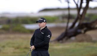 Ted Potter Jr. follows his shot from the 12th fairway of the Monterey Peninsula Country Club Shore Course during the second round of the AT&T Pebble Beach Pro-Am golf tournament on Friday, Feb. 8, 2013 in Pebble Beach, Calif. (AP Photo/Eric Risberg)