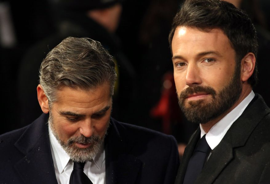 Ben Affleck (right) and George Clooney arrive for the BAFTA Film Awards at the Royal Opera House on Sunday, Feb. 10, 2013, in London. (Ki Price/Invision/AP)