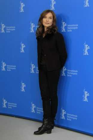 "French actress Isabelle Huppert poses at the photo call for the film ""The Nun"" at the 63rd edition of the Berlin International Film Festival in Berlin on Sunday, Feb.10, 2013. (Joel Ryan/Invision/AP)"