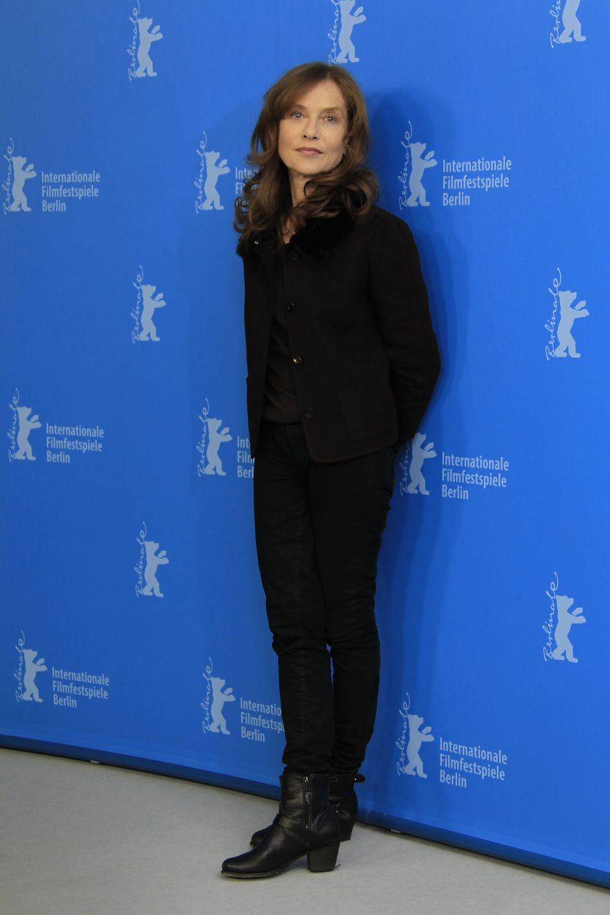"""French actress Isabelle Huppert poses at the photo call for the film """"The Nun"""" at the 63rd edition of the Berlin International Film Festival in Berlin on Sunday, Feb.10, 2013. (Joel Ryan/Invision/AP)"""