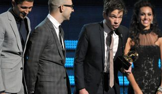 """Members of Fun (from left) Nate Ruess, Andrew Dost and Jack Antonoff accept the award for song of the year for """"We Are Young"""" at the Grammy Awards on Sunday in Los Angeles. (Associated Press)"""