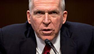 **FILE** John Brennan (Associated Press)