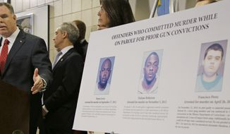 Chicago Police Superintendent Garry McCarthy points to a poster showing three offenders that committed murders while on parole for prior gun convictions during a news conference in Chicago on Feb. 11, 2013. During the news conference McCarthy Chicago Mayor Rahm Emanuel and Cook County State's Attorney Anita Alvarez said they'll push for state legislation that increases the minimum sentences for those who violate the state's gun laws. (Associated Press)