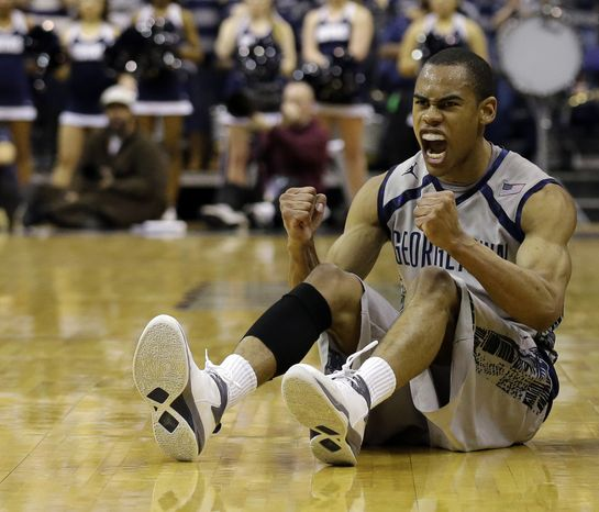 Georgetown guard Markel Starks (5) celebrates after a play during the first half of an NCAA college basketball game against Marquette, Monday, Feb. 11, 2013, in Washington. (AP Photo/Alex Brandon)