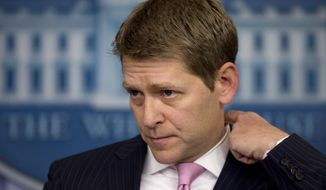 ** FILE ** White House press secretary Jay Carney pauses as he speaks during his daily news briefing at the White House in Washington on Friday, Feb. 1, 2013. (AP Photo/Carolyn Kaster)