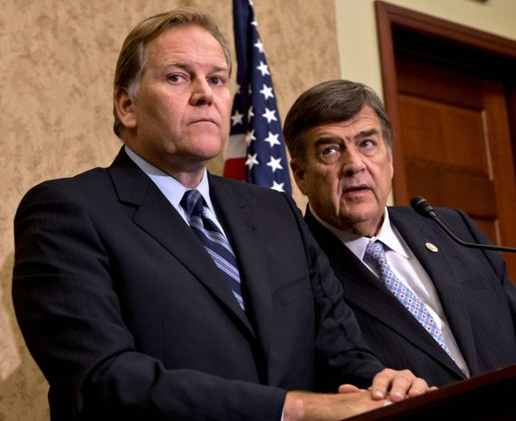 """""""We will closely review the President's executive order once it is released but we agree that our biggest barriers to bolster our cyber defenses can be fixed only with legislation,"""" Reps. Mike Rogers, Michigan Republican (left), and C.A. """"Dutch"""" Ruppersberger, Maryland Democrat, said in a statement. (Associated Press)"""