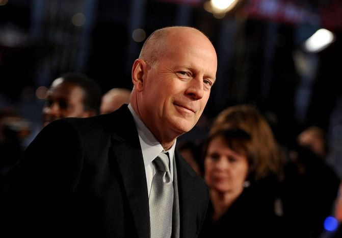 """**FILE** Bruce Willis arrives for the premiere of the movie """"A Good Day to Die Hard"""" in Berlin on Feb. 4, 2013. (Associated Press/dpa, Britta Pedersen)"""