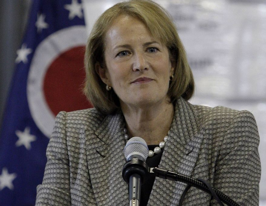 ** FILE ** In this Tuesday, May 10, 2011, file photo, Karen Mills, of the Small Business Administration, participates in a discussion, in Dayton, Ohio. Mills is stepping down. (AP Photo/Al Behrman, File)