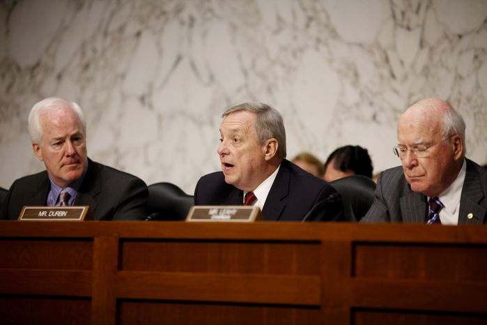 ** FILE ** In this Tuesday, June 28, 2011, file photo, Sen. Richard Durbin, D-Ill., center, flanked by Sen. John Cornyn, R-Texas, left, and Sen. Patrick Leahy, D-Vt., speaks during a meeting on Capitol Hill in Washington. The Senate holds its second hearing Tuesday, Feb. 12, 2013, on gun curbs since the December 2012 shooting deaths of 20 first-graders in Newtown, Conn. (AP Photo/Charles Dharapak, File)