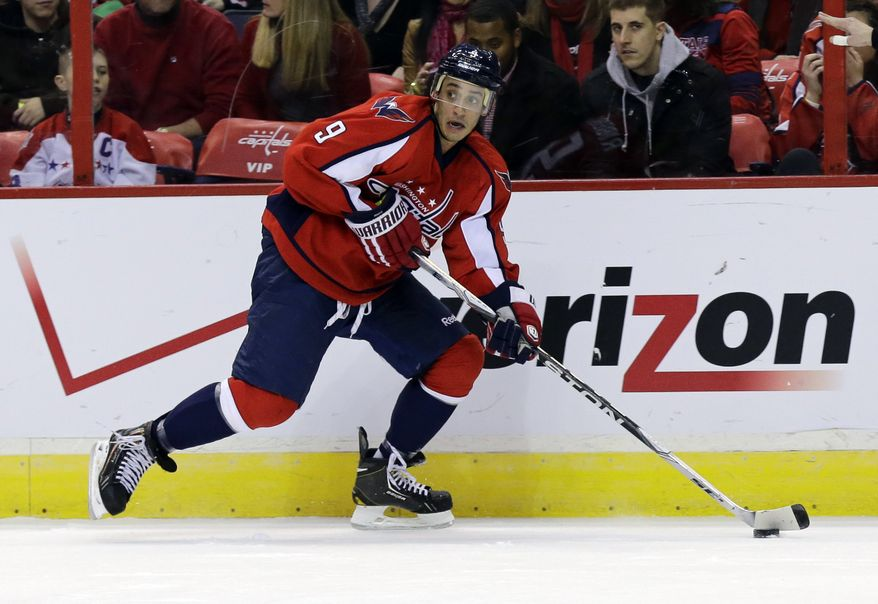 Washington Capitals center Mike Ribeiro (9) skates with the puck in the first period of an NHL hockey game against the Toronto Maple Leafs Tuesday, Feb. 5, 2013 in Washington. (AP Photo/Alex Brandon)