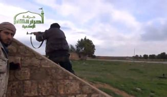 Syrian rebels are pictured at the Jarrah airfield in Syria's northern Aleppo province on Tuesday, Feb. 12, 2013, in this image taken from video and authenticated based on its contents and other AP reporting. (AP Photo/Ugarit News via AP video)