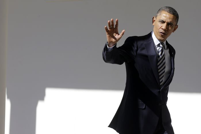President Obama waves as he walks down the West Wing Colonnade of the White House on Feb. 12, 2013, ahead of State of the Union speech on Capitol Hill later that day. (Associated Press)