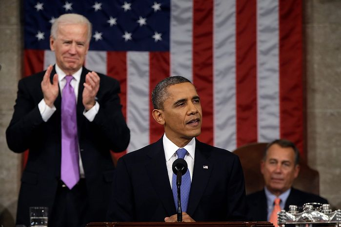 Vice President Joe Biden applauds as President Barack Obama gives his State of the Union address during a joint session of Congress on Capitol Hill in Washington, Tuesday Feb. 12, 2013. House Speaker John Boehner of Ohio sits at right. (AP Photo/Charles Dharapak, Pool)