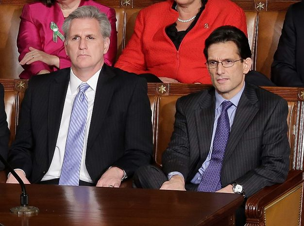 House Majority Whip Kevin McCarthy of Calif. left, and House Majority Leader Eric Cantor listen during President Barack Obama's State of the Union address during a joint session of Congress on Capitol Hill in Washington, Tuesday Feb. 12, 2013. (AP Photo/J. Scott Applewhite)