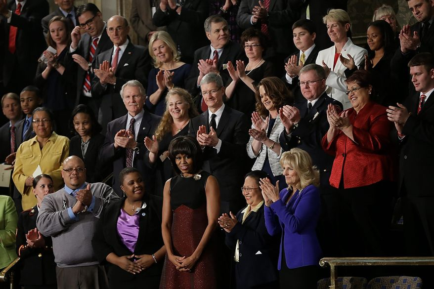 First lady Michelle Obama is applauded before President Barck Obama's State of the Union address during a joint session of Congress on Capitol Hill in Washington, Tuesday Feb. 12, 2013. Front row, from left are, Sgt. Sheena Adms, Nathaniel Pendleton, Cleopatra Cowley-Pendleton, Mrs, Obama, Menchu de Luna Sanchez and Jill Biden. Second row, third from left are, Oregon Gov. John Kitzhaber, Deb Carey and Apple CEO Tim Cook Amanda McMillian, Lt. Brian Murphy, (AP Photo/Pablo Martinez Monsivais)