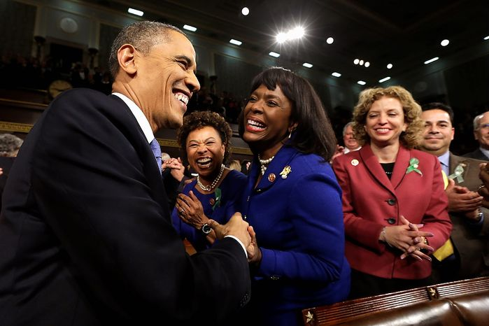 President Barack Obama is greeted before giving his State of the Union address during a joint session of Congress on Capitol Hill in Washington, Tuesday Feb. 12, 2013. (AP Photo/Charles Dharapak, Pool)