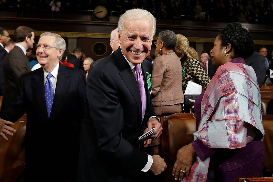 Vice President Joe Biden, Senate Minority Leader Mitch McConnell of Ky., left, Rep. Shelia Jackson Lee, D-Texas, right, and others arrive on Capitol Hill in Washington, Tuesday, Feb. 12, 2103, for President Barack Obama's State of the Union address during a joint session of Congress. (AP Photo/Charles Dharapak, Pool)
