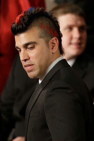 Bobak Ferdowsi, flight director, Mars Curiosity Rover, arrives as a guest of first lady Michelle Obama for President Barack Obama's State of the Union address, Tuesday, Feb. 12, 2103, on Capitol Hill in Washington. (AP Photo/Pablo Martinez Monsivais)
