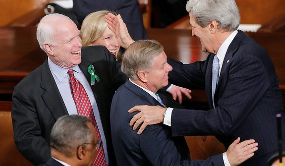 Secretary of State John Kerry, right, greets Sen. Lindsey Graham, R-S.C., center, and Sen. John McCain, R-Ariz, before President Barack Obama's State of the Union address during a joint session of Congress on Capitol Hill in Washington, Tuesday Feb. 12, 2013. (AP Photo/J. Scott Applewhite)