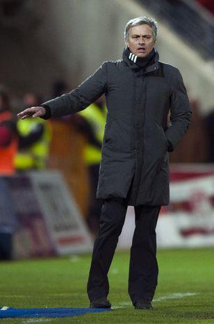 Real Madrid's coach Jose Mourinho from Portugal gestures during his team's Spanish La Liga soccer match against Granada at Los Carmenes stadium in Granada, Spain, Saturday, Feb. 2, 2013. (AP Photo/Daniel Tejedor)