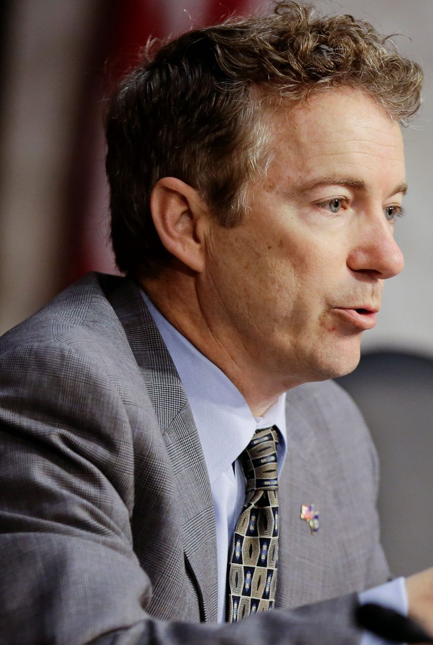 Sen. Rand Paul, Kentucky Republican, says he will not allow a vote on John O. Brennan as director of the CIA until he answers his question on drones. (Associated Press)