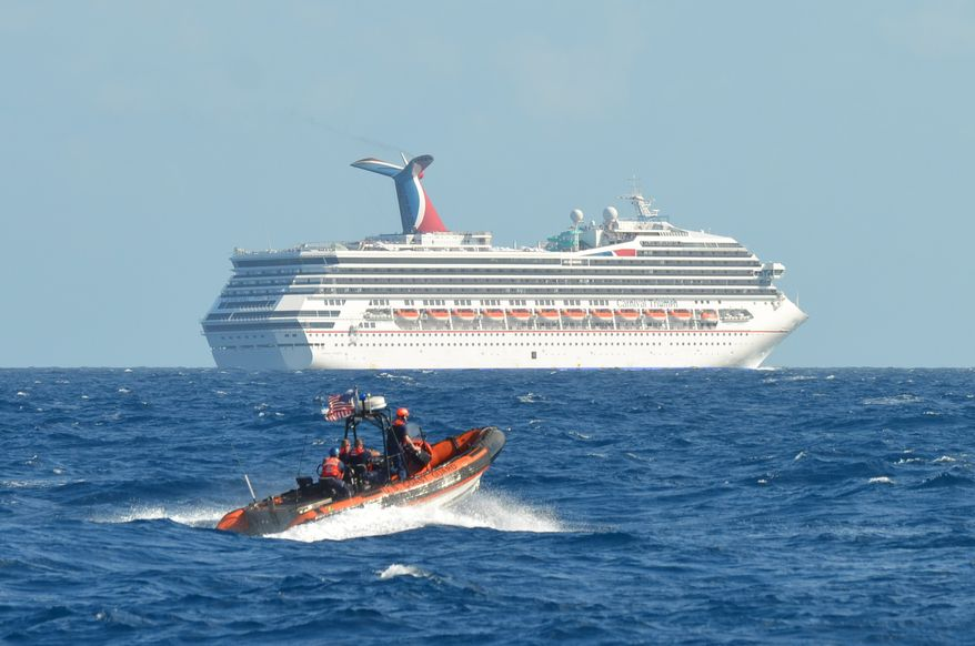 ** FILE ** A small boat belonging to the U.S. Coast Guard Cutter Vigorous patrols on Monday, Feb. 11, 2013, near the cruise ship Carnival Triumph in the Gulf of Mexico. The Carnival Triumph has been floating aimlessly about 150 miles off the Yucatan Peninsula since a fire erupted in the aft engine room a day earlier, knocking out the ship's propulsion system. No one was injured and the fire was extinguished. (Associated Press/U.S. Coast Guard)