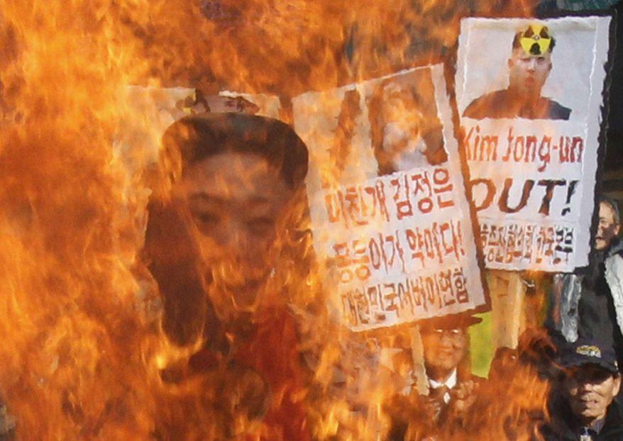 South Korean protesters burn an effigy of North Korean leader Kim Jong-un during an anti-North Korea rally denouncing the North's nuclear test in Seoul, South Korea, Wednesday, Feb. 13, 2013. (AP Photo/Ahn Young-joon)
