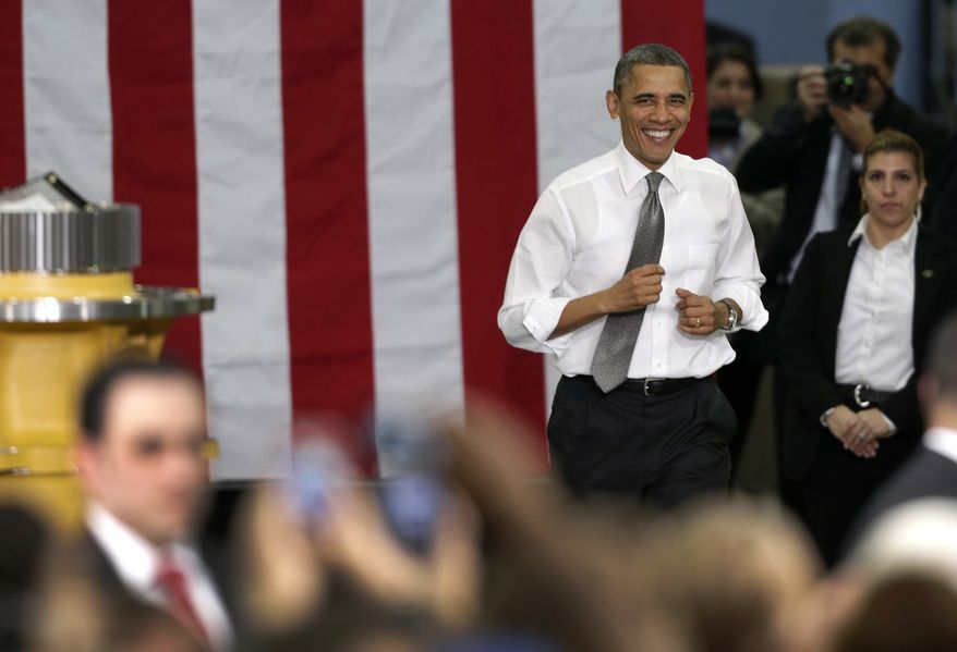 President Obama runs to the stage before speaking to workers and guests at the Linamar Corporation plant in Arden, N.C., on Feb. 13, 2013, as he travels after delivering his State of the Union address. (Associated Press)