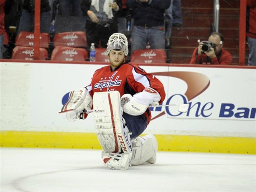 Washington Capitals goalie Braden Holtby (70) looks on during a break in the action against the Florida Panthers during the second period of an NHL hockey game, Saturday, Feb. 9, 2013, in Washington. (AP Photo/Nick Wass)