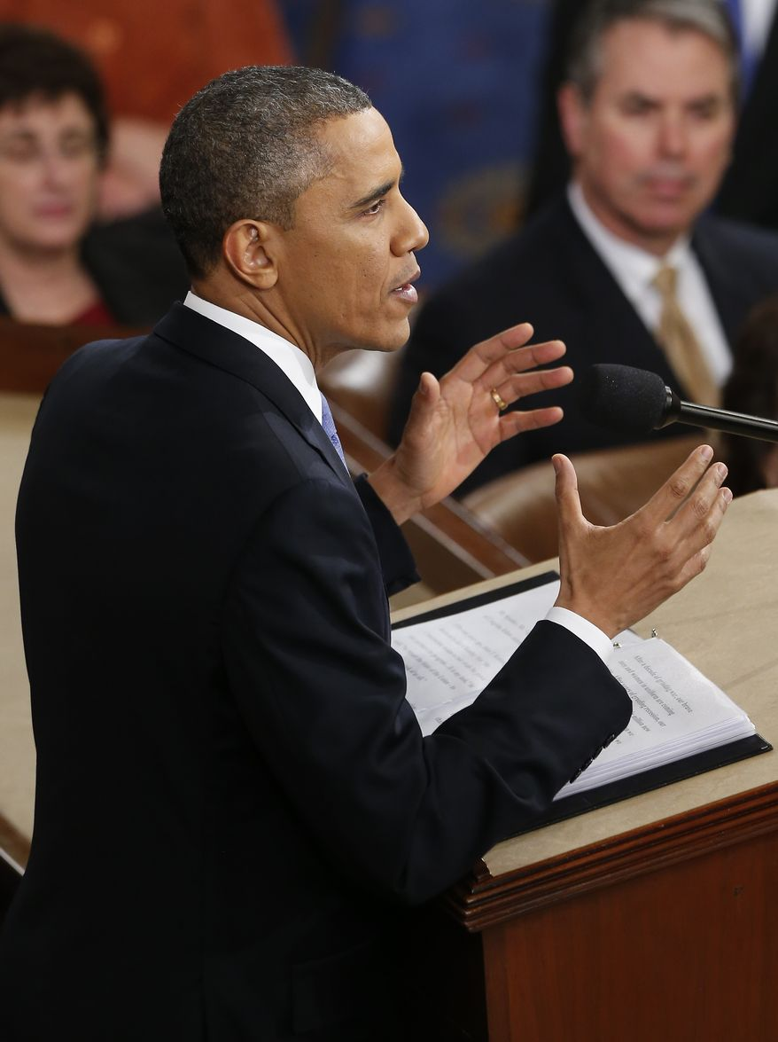 President Obama gestures as he gives his State of the Union address during a joint session of Congress on Capitol Hill in Washington on Tuesday, Feb. 12, 2013. (AP Photo/J. Scott Applewhite)