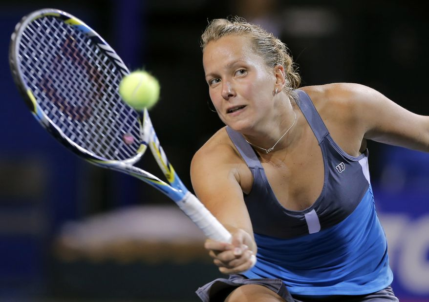 **FILE** Barbora Zahlavova Strycova of the Czech Republic volleys the ball as she plays Italy's Roberta Vinci during their first round match of the Japan Pan Pacific Open tennis tournament in Tokyo, Sunday, Sept. 23, 2012. (AP Photo/Shuji Kajiyama)