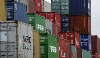 ** FILE ** In this Jan. 11, 2012, file photo, containers are piling at the harbor in Duisburg, Germany. (AP Photo/Frank Augstein, File)