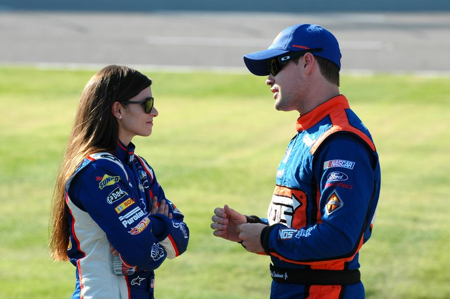 **FILE** In this Nov. 3, 2012, file photo, drivers Danica Patrick, left, talks with Ricky Stenhouse Jr., as they wait on pit road during qualifying for a NASCAR Nationwide series auto race at Texas Motor Speedway in Fort Worth, Texas. Patrick slid into her chair at NASCAR media day Thursday, Feb. 14, 2013 and promptly informed her audience she'd only answer racing-related questions. Then she proceeded to talk candidly about her relationship with fellow driver Ricky Stenhouse Jr. .(AP Photo/Randy Holt, File)